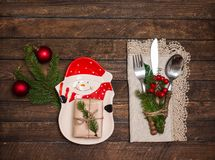 Vintage rustic cutlery set with lacy napkin and Christmas decora stock photo