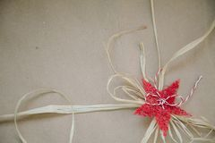 Vintage rustic decoration of red lace and rope. Copy space stock photography
