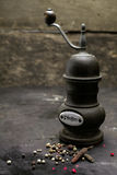 Vintage rustic pepper grinder or mill Stock Photography