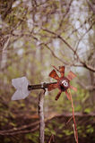 Vintage rustic windmill in early spring garden Stock Image