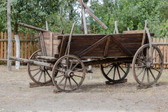 Vintage rustic wooden horse-drawn carriage in Polish farm Stock Photography