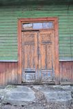 Vintage rustic wooden house with old door close up, conceptual image. Abandonned russian traditional village. Old wood plank. Rustic wooden house with old door royalty free stock photography