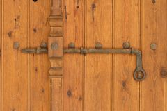 Vintage rusty deadbolt on the old wooden door. horizontal Royalty Free Stock Photography
