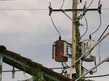 Vintage Rusty Distribution Transformer/ Electric Box On Pole Stock Photo
