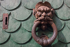Vintage rusty door knocker in Pisa Italy Royalty Free Stock Images