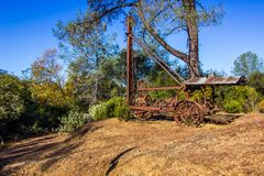 Vintage Rusty Drilling Machine Once Used In Mining Operations. Abandoned In On Mountain stock image