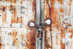 Vintage rusty gate with locked master key and chain Stock Photos