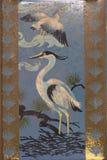 Vintage rusty heron bird themed tin Stock Images