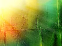 Vintage rusty metal plate texture with dramatic light leak background stock image