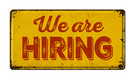 We are hiring. Vintage rusty metal sign on a white background - We are hiring stock photography
