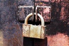 Vintage rusty padlock metal gates Stock Image