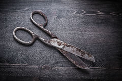 Vintage rusty pair of scissors on wooden board Stock Photo