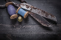 Vintage rusty scissors spool of thread thimble on Stock Photo