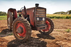 Vintage rusty tractor. A rusty red tractor abandoned in the sicilian fields stock photo