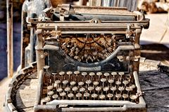 Vintage rusty typewriter on a barrel royalty free stock photo