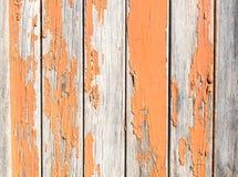 Vintage rusty wood background with orange paint Stock Photos
