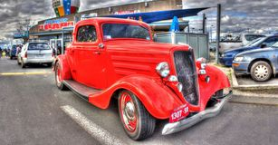 Vintage 1930s American Ford. Vintage 1930s red American Ford with suicide doors on display at car and bike show in Melbourne, Australia Royalty Free Stock Photo
