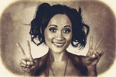 Vintage 50s asian woman showing peace sign on hand Royalty Free Stock Image