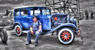 Vintage 1920s Australian Chrysler. Vintage 1920s Australian made Blue Chrysler with man in period clothing on display at car show in Melbourne, Australia on a Stock Image