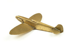 Vintage 1940s brass toy airplane on white background stock photos