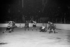 Vintage 1950's Bruins, Canadiens game. Vintage 1950's image of the Boston Bruins battling the Montreal Canadiens. (Image from B&W negative stock photography