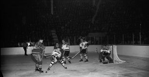 Vintage 1950's Bruins, Canadiens game. Vintage 1950's image of the Boston Bruins battling the Montreal Canadiens. (Image from B&W negative royalty free stock image