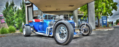 Vintage 1920s Ford hot rod. Vintage blue 1920s Ford hot rod with no hood and open motor bay on display at car show in Melbourne, Australia Stock Photos