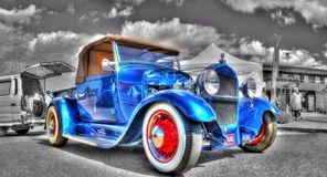 Vintage 1920s hot rod. Vintage blue 1920s Ford hot rod with a black and white background Stock Photography