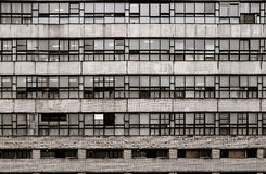 Vintage 70s housing in St Petersburg Russia grunge wall with closed windows and rusty metal grids Royalty Free Stock Photography