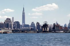 Vintage 1950`s Manhattan Skyline with Empire State Building stock images