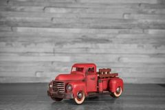 Vintage 1950`s red pickup truck on a black and white background royalty free stock image