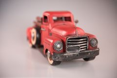 Vintage 1950`s red toy metal pickup truck royalty free stock images