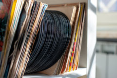 Vintage 45s vinyl row on house shelf Stock Images