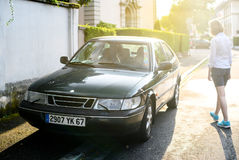 Vintage Saab 900 coupe and beautiful swedish girls at sunset Royalty Free Stock Photography