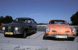 Vintage Saab and Volkswagen parked Stock Photos