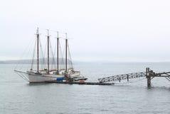 Foggy Harbor Vintage Sailboat. Vintage Sailboat in Foggy Harbor, Maine United States Stock Photo