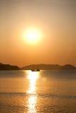 Vintage sailboat sailing in the sea. At sunrise Stock Image
