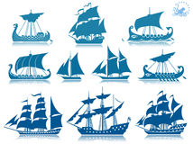 Vintage sailing boats. Illustrated set of blue vintage and historical sailing ships and boats, white studio background Stock Image