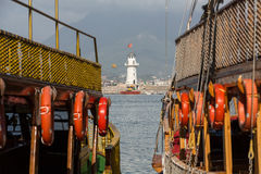 Vintage sailships and Lighthouse in the port of Alanya, Royalty Free Stock Photography