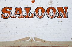 Vintage saloon sign. Grunge vintage western saloon sign Royalty Free Stock Photo