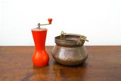 Vintage salt bowl and pepper grinder on wood table. Classic italian salt bowl and pepper grinder Royalty Free Stock Image