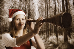 Vintage santa elf searching for Christmas fun Royalty Free Stock Photography