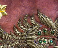 Vintage sari fabric with embellishments. Close up detail of vintage sari fabric with goldwork and beads Royalty Free Stock Photography