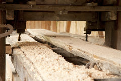 Vintage sawmill. Working lengthways on a beam Royalty Free Stock Photography