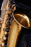 Vintage Saxophone. On blue background Royalty Free Stock Photography