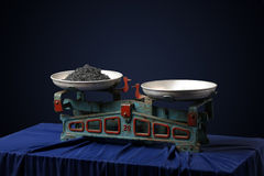 Vintage scales with a black caviar. On dark background stock photography
