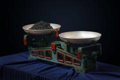 Vintage scales with a black caviar 2. Vintage scales with a black caviar on dark background stock photo