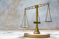 Vintage scales of justice out of balance Stock Photos