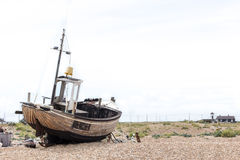 Vintage scene with old worn boats seen ashore Stock Photo