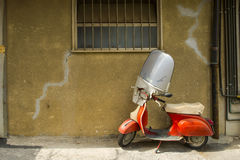 Vintage scene with Vespa on old street. Siena italy Stock Photography